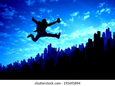 Silhouette of businessman jumping against sunset background