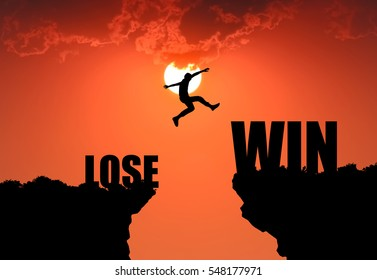 Silhouette of businessman  jumping from LOSE to WIN on sunrise background. business concept