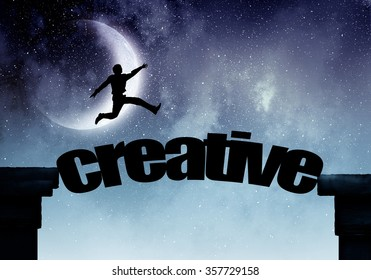 Silhouette of businessman over moon