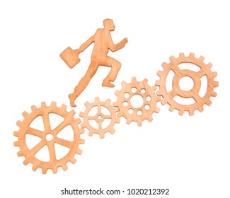 silhouette of a businessman with a portfolio going to success through a set of gears. Growth, promotion and teamwork. Made of natural wood. on white background isolated. Concept career ladder
