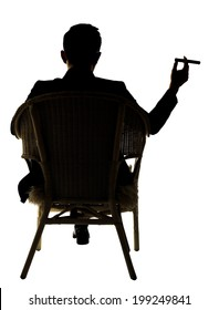 Silhouette of businessman sit on chair and hold a cigar, full length portrait isolated on white background.