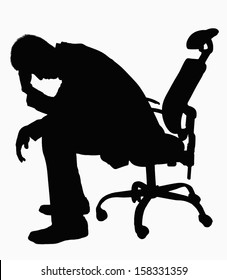 Silhouette of businessman sitting with hand on his head