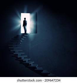 Silhouette of businessman standing in doorway light