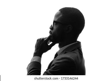 Silhouette of businessman thinking something.