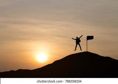 Silhouette of businessmen are jumping to celebrate success on top of hill, sky and sun light background. Business, successful, leadership, achievement, teamwork and goal concept.