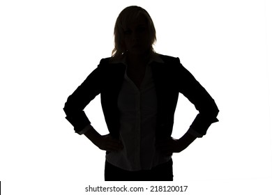 Silhouette of businesswoman with hands on hips on white background