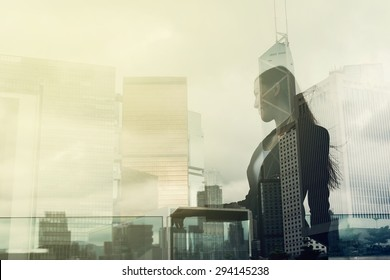 Silhouette of businesswoman stand and look far away in Hong Kong, Asia. Double exposure.
