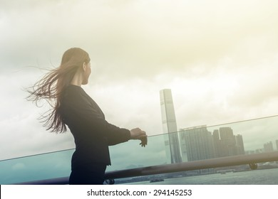 Silhouette of businesswoman stand and look far away in Hong Kong, Asia.