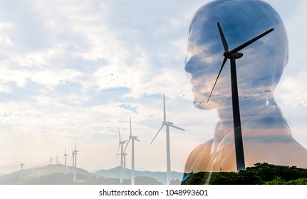 Silhouette of businesswoman and wind power generation. Environmental issues concept.
