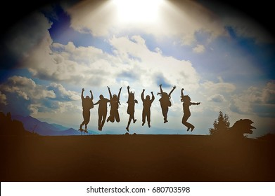 Silhouette of bussiness teamwork group jump from the top of mountain to cross the sky for success. Business success and teamwork concept. Blue sky background. (Selective focus).