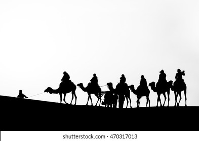 Silhouette of a Camel Caravan in the Sahara Desert in Monochromatic Color