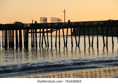 Silhouette of Capitola Wharf, Capitola Beach, CA at sunset.