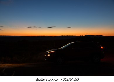 Silhouette of a car during sunset.