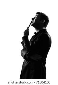 silhouette caucasian business man thinking pensive behavior full length on studio isolated white background