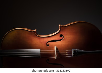 Silhouette of a Cello on black background with copy space for music concept