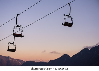Silhouette of chairlifts at sunset in spring