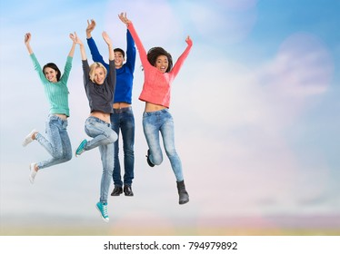 245ec4e55600d Silhouette of cheering young generation jumping on outdoor beautiful Rear  view background. relax lifestyle hope
