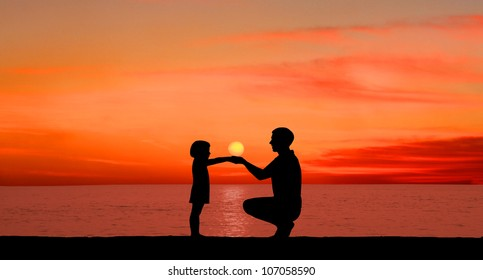 Silhouette of the child with the father on a sunset
