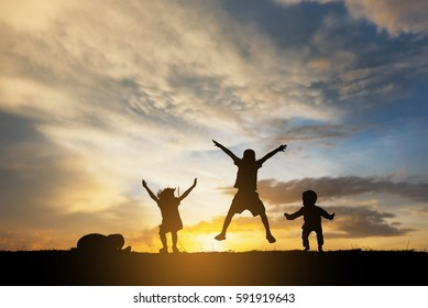 silhouette children jump