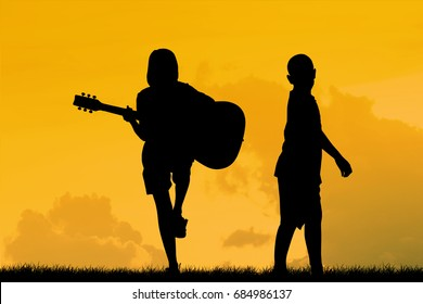 silhouette of children, jumping and dancing and having fun with dreams of being a musician.