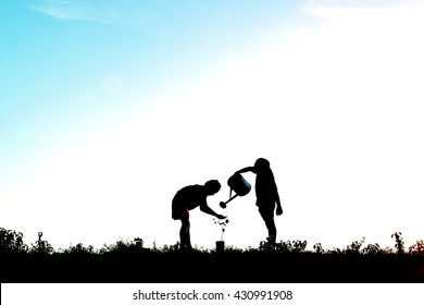 Silhouette of children planting a tree. Concept save the world and earth day
