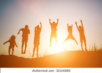 Silhouette of Children playing on summer sunset happy time