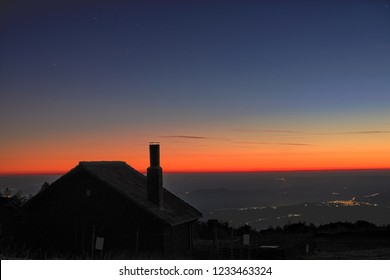 silhouette chimney of mountain refuge at twilight in Etna Park, Sicily