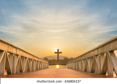 silhouette christian cross and wooden bridge with over sunset and color sky,religion concept