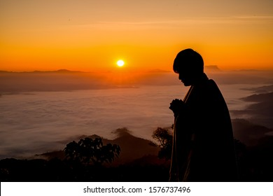 Silhouette of christian man hand praying,spirituality and religion,man praying to god. Christianity concept.