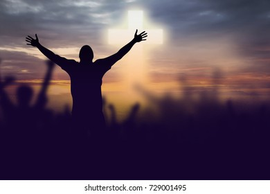 Silhouette of Christian prayers raising hand while praying to the Jesus