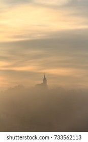 Silhouette of a church in a foggy morning