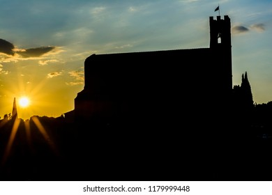 The silhouette of the church of Saint Dominic (San Domenico) in Siena, Toscany, during the sunset