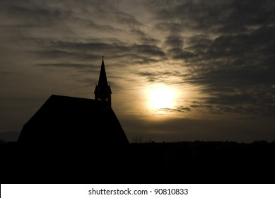 silhouette of church in sunset