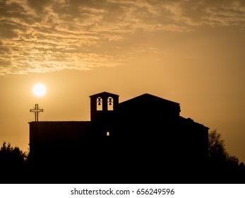 Silhouette of a church at sunset in Hoces del Duratón (Segovia, Spain)