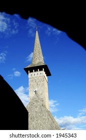 silhouette of a church tower on the blue sky