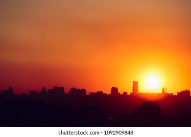 silhouette of city buildings in the sunset. background with beautiful outlines of the city. Red sunset