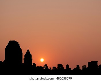Silhouette of city at sunset. Digital retouch.