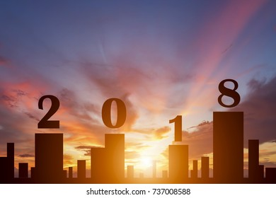 Silhouette of city in sunset with text 2018 for new year concept