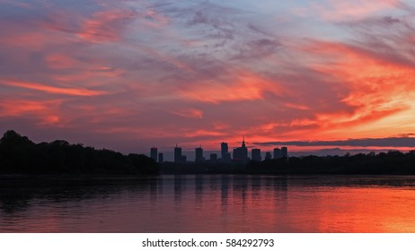 Silhouette of the city of Warsaw against the sky at sunset