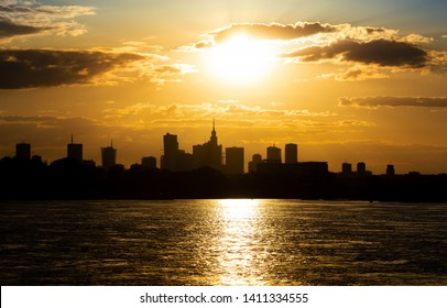 Silhouette of the city of Warsaw. Golden sunset