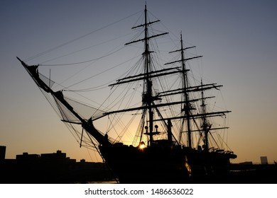 Silhouette of a classic three-master sail ship at dawn in the ports of Amsterdam