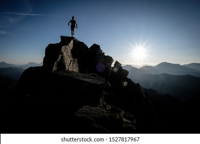 Silhouette if a climber on alpine ridge