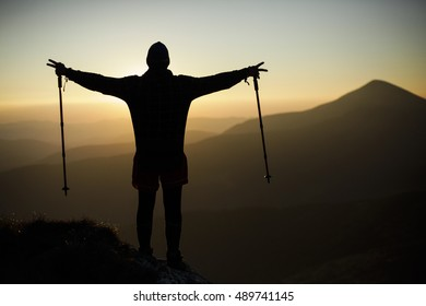 Silhouette of a climber on the high mountain. Sport and active life