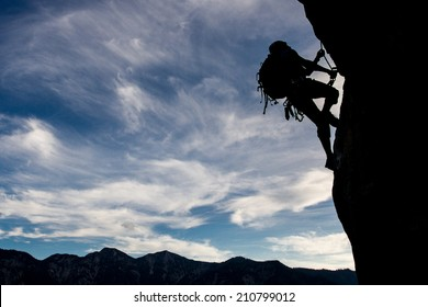 Silhouette of a climber on a vertical wall
