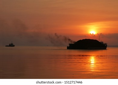 silhouette of coal barges in the sea of ​​Paser Regency, East Kalimantan, Indonesia