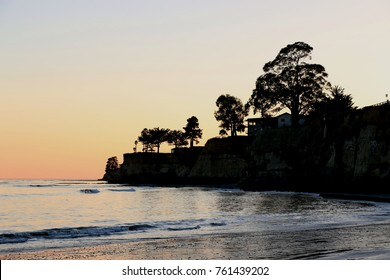 Silhouette of the coast at sunset, Capitola Beach, CA.
