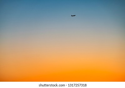 Silhouette of a Commercial Plane at Sunset