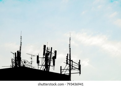 silhouette communication system on building, radio tower, satellite, antenna and cellular repeater.