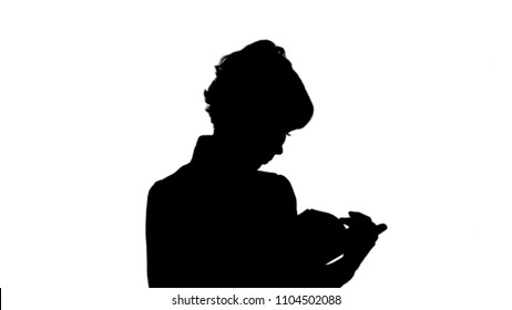 Silhouette Concentrated young business woman holding and reading book track matte