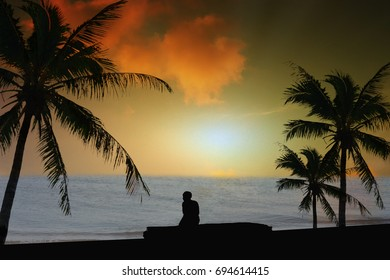 Silhouette Concept  Men sit alone sit relax With atmosphere Sea sky In the evening.